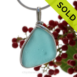 This is a beautiful thick vivid Aqua Blue Sea Glass set in our Original Wire Bezel© pendant setting in Sterling Silver. SOLD - Sorry this Rare Sea Glass Pendant is NO LONGER AVAILABLE!