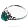 A very nice piece of vivid teal or turquoise green beach found sea glass set in a solid sterling silver scroll ring.