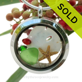 Green Sea Glass With a Real Starfish, Red and Green Gems, a real Sandollar & Real Sand Locket. SOLD - Sorry this Sea Glass Locket is NO LONGER AVAILABLE!