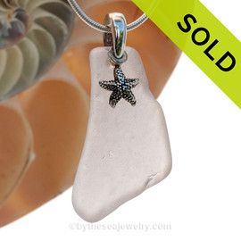 A LARGER piece of  Lavender or Purple sea glass on a professionally hand cast sterling bail with a solid sterling Starfish charm.  SOLD - Sorry this Sea Glass Necklace is NO LONGER AVAILABLE!