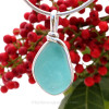 This is a beautiful Bubbly Vivid Aqua Blue Sea Glass set in our Original Wire Bezel© pendant setting in Sterling Silver .