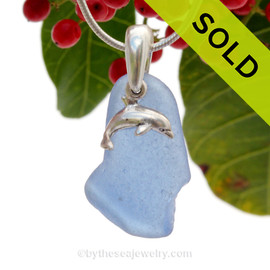 Not perfect but rare Carolina Blue beach found Sea Glass Necklace set on a Solid Sterling cast bail with a sterling silver Dolphin Charm. SOLD - Sorry this Sea Glass Necklace is NO LONGER AVAILABLE!