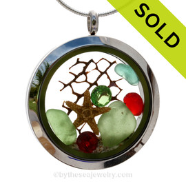 Green , aqua and small red sea glass and a real starfish and beach make this a great locket necklace for the holidays. Ruby Red AND Peridot Green crystal gems finish the locket with some extra bling. SOLD - Sorry this Sea Glass Locket is NO LONGER AVAILABLE!