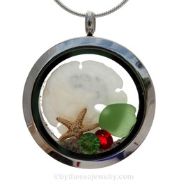 Green sea glass and a real starfish and Sandllar make this a great locket necklace for the holidays. Ruby Red AND Peridot Green crystal gems finish the locket with some extra bling.