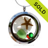 Green sea glass and a real starfish and Sandllar make this a great locket necklace for the holidays. Ruby Red AND Peridot Green crystal gems finish the locket with some extra bling. SOLD - Sorry this Sea Glass Locket is NO LONGER AVAILABLE!