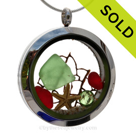 Green and Rare Red sea glass and a real starfish make this a great locket necklace for the holidays. Peridot Green crystal gem finish the locket with some extra bling.