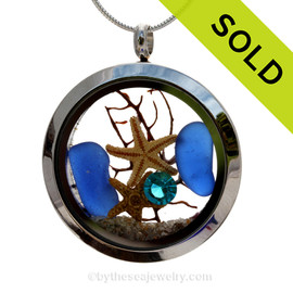 Genuine Cobalt Blue sea glass pieces combined with a small real starfish and a bit of seafan combined with crystal turquoise gem stainless steel locket. SOLD - Sorry this Sea Glass Locket is NO LONGER AVAILABLE!