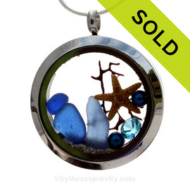 Genuine Cobalt Blue sea glass pieces combined with a small real starfish and a bit of seafan combined with crystal aquamarinegem , pearls in this  stainless steel locket. SOLD - Sorry this Sea Glass Locket is NO LONGER AVAILABLE!