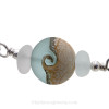 A detail of the top quality genuine sea glass pieces and the lovely handmade light sea green wave bead.