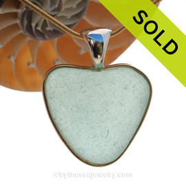 A stunning thick and frosty HUGE Seafoam Green NATURAL found sea glass heart in our deluxe wire bezel pendant setting!  Genuine sea glass hearts are a RARE phenomena and cherished among sea glass lovers!