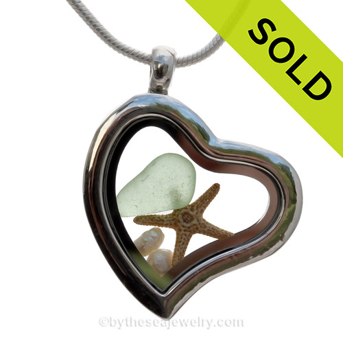 A Beautiful piece of of Genuine Seafoam Green Sea Glass combined with a real  Real Starfish and  fresh water pearls.