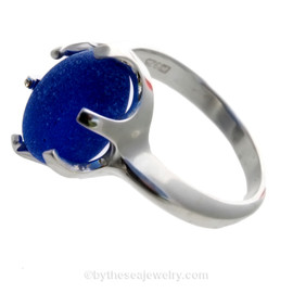 A stunning and perfect vivid electric cobalt blue sea glass in a secure ring setting.