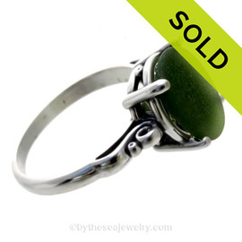 A stunning beautiful piece of vivid Seaweed green sea glass from set in a silver ring.