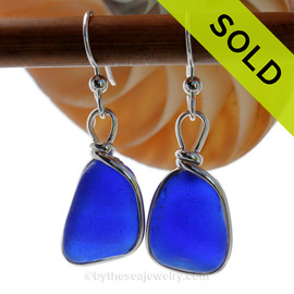 Very Thick and Vivid Cobalt Blue Sea Glass Earrings in our Original Wire Bezel© Sterling Silver setting. Our original Wire Bezel Earring setting lets all the beauty of these beauties shine! This setting does not alter the sea glass from the way it was found on the beach.  SOLD - Sorry these Rare Sea Glass Earrings are NO LONGER AVAILABLE!