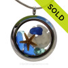 Cobalt Blue & Aqua Sea Glass in a crystal and stainless steel locket combined with a sandollar and baby starfish and an Aquamarine crystal gem. SOLD - Sorry this Sea Glass Locket is NO LONGER AVAILABLE!