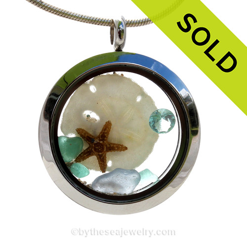 Pretty Pastels of Light Blue and Aqua inside this crystal and stainless steel locket combined with real baby Sandollar and an Aquamarine crystal gem. SOLD - Sorry this Sea Glass Locket is NO LONGER AVAILABLE!