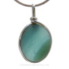 A vivid glowing storm blue sea  and spring green glass piece in our Original Wire Bezel© pendant setting. This amazing TOP QUALITY sea glass originates from Seaham England and is the result of years of glass factories discarding their scraps into local waters.