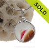 Resembling an ice cream sundae this rare piece of mixed pink, gold and amber sea glass in a base of pure white endoday sea glass from England set in our Original Wire Bezel© necklace pendant setting.