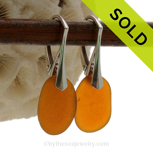 Genuine Perfect Glowing Amber Brown Sea Glass Earring shaped only by the sea, sand and time are suspended on solid sterling leverback earrings.