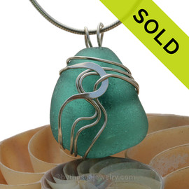 A stunning and LARGE PERFECT Genuine Electric Aqua Green Sea Glass Pendant set in our Signature Waves© setting in Sterling Silver.