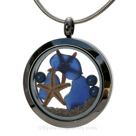 Cobalt Blue  Sea Glass in a crystal and stainless steel locket combined with a two baby starfish and vivid blue pearls. Finished with real beach sand for your personal beach on the go!