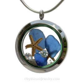 Cobalt Blue Sea Glass in a crystal and stainless steel locket combined with a two baby starfish and vivid White Crystal Gems. Finished with real beach sand for your personal beach on the go!