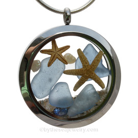 A Beautiful Slice of the Sea in this real Carolina Blue Genuine Sea Glass Locket that combines with a REAL Starfish, Fresh Water Pearls, and a Aquamarine Gems. Finished with real beach sand for your own personal beach on the go!