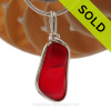 A once in a lifetime piece of large fire red sea glass is set in our Original Wire Bezel© pendant setting.