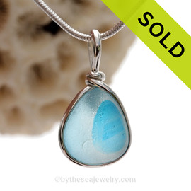 A Lovely Petite Flashed Electric Aqua Blue multi sea glass set in Sold Sterling Silver Deluxe Wire Bezel© pendant setting.