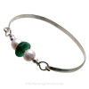 Perfect Deep Teal Green English Sea Glass combined with real cultured pearls on this Solid Sterling Silver Full round Sea Glass Bangle Bracelet.