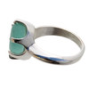A perfect natural and unaltered sea glass piece set in a solid sterling ring