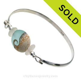 Genuine Pure White Sea Glass Bangle Bracelet set with a handmade lamp work glass wave bead in aqua with sterling end beads on a solid sterling half round premium bangle bracelet. SOLD - Sorry this Sea Glass Bangle Bracelet is NO LONGER AVAILABLE!
