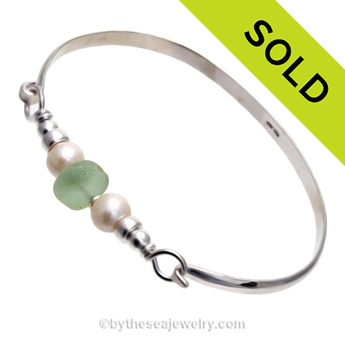 Perfect Soft Sea Green English Sea Glass combined with real cultured pearls on this Solid Sterling Silver half  round Sea Glass Bangle Bracelet.