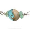 A detail of this beautiful handmade aqua wave bead and the genuine aqua sea glass.