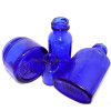 Vintage cobalt blue bottles the source of blue sea glass pieces.