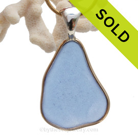 An Elegant and versatile. A great pendant for any necklace. A nice piece of cobalt blue sea glass set in a mixed metal gold and sterling silver necklace.