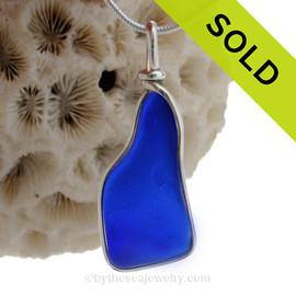 A VIVID Cobalt Blue long an irregular sea glass set in our Original Deluxe Wire Bezel© necklace pendant.