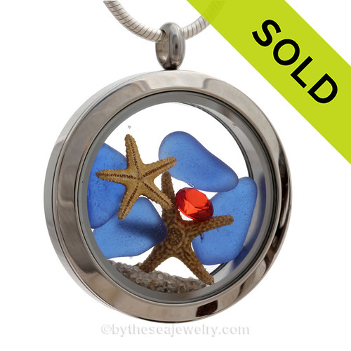 Cobalt Blue Sea Glass in a crystal and stainless steel locket combined with a baby starfish and crystal gems.   SOLD - Sorry This Sea Glass Locket is NO LONGER AVAILABLE!