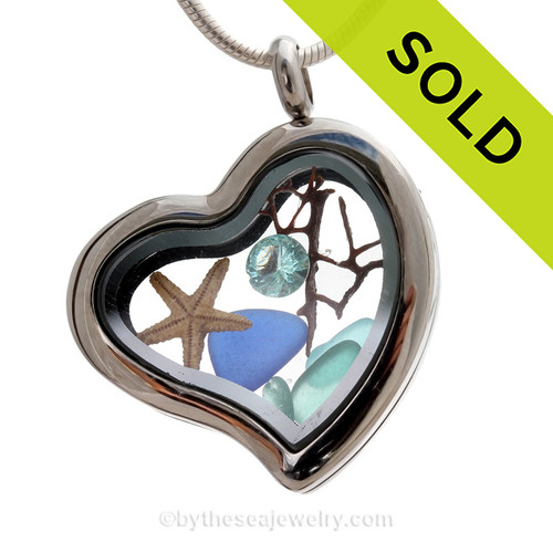 Beautiful pieces cobalt blue and aqua sea glass pieces combined with a real starfish in this Genuine Sea Glass Heart Locket Necklace. SOLD - Sorry This Sea Glass Locket is NO LONGER AVAILABLE!