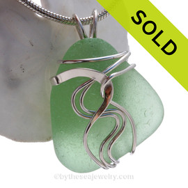 A nice Good QUALITY piece of yellowy seafoam green sea glass set in our signature Waves© setting in sterling silver.