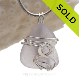 "A beautiful natural lavender sea glass jewelry set in our original signature ""Waves"" setting in solid sterling silver."