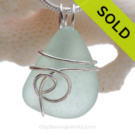 This natural sea glass piece is Seafoam Green Genuine Sea Glass In Sterling Sea Swirl Setting Pendant for Necklace.