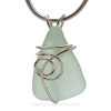 A simple and secure setting that leaves most of the sea glass pendant unaltered from the way it was found on the beach