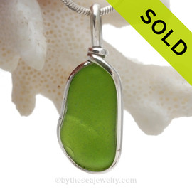 A Long and vivid Chartreuse or Electric Lime Green sea glass piece set in our Original Wire Bezel© setting.