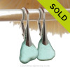 Thick Beach Found Aqua Genuine Sea Glass Earrings on Sterling Silver Leverbacks. We meticulously sort though hundreds of pieces of beach found sea glass to find one pair that is similar in shape, size and hue! Aqua sea glass becomes increasing as each wave passes.
