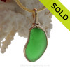 A cool perfect VIVID Glowing Green Genuine Sea Glass set in our Original Wire Bezel© setting in 14K Rolled Gold. It has been left just as it was found and is UNALTERED from the way it was found on the beach on the Outer Banks of NC.