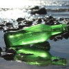 Many green sea glass pieces started out as beer and soda bottles tossed into the sea.