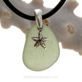 A nice piece of Light Peridot Green Natural Sea Glass Necklace Set On Silver Bail With Black Neoprene Cord with sterling clasps and finished with a solid sterling Starfish Charm.