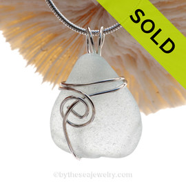 This natural sea glass piece is Pure Bright White Genuine Sea Glass In Sterling Sea Swirl Setting Pendant for Necklace.