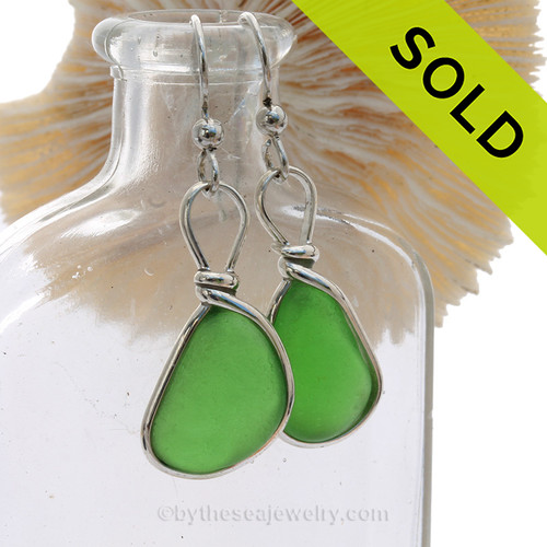 Genuine Naturally Pieces of Green Sea Glass in a Sterling Silver Earring set in our Original Wire Bezel© Setting. This setting leaves the glass UNALTERED from the way it was found on the beach.  This pair is set in Solid Sterling Silver and will last a lifetime.  TOP QUALITY sea glass fro Puerto Rico